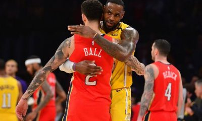 Lonzo Ball and LeBron James embrace